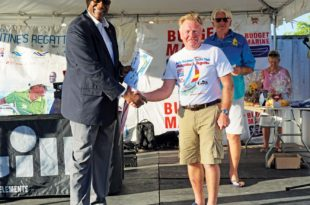 Sir Rodney Williams, KGN, GCMG presents 3rd place in Cruising Class to Jolly Harbour Yacht Club Commodore Grahame Williams