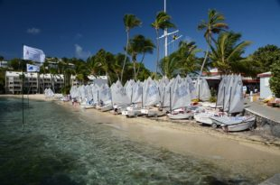 Optimist dinghies lined up on the beach in front of the St. Thomas Yacht Club. Credit: Dean Barnes