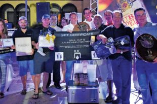 Top Boat and winning team Casca Dura collect their prizes. Photo: GLEO