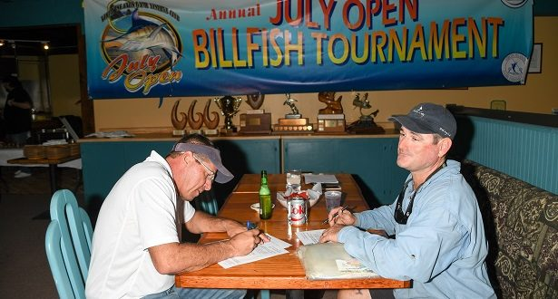 Captain Jay Fowler of the Pescador (L) and Captain Rob Richards of Mixed Bag (R) register for the July Open Billfish Tournament. Credit Dean Barnes