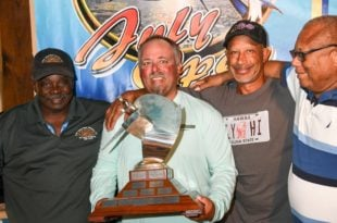 Top Angler Chad Damron, second from left, with Capt. Spike Herbert (far left), VIGFC Board Member, Dr. Brian Biscoe (second from right), and Capt. Red Bailey (far right). Credit: Dean Barnes